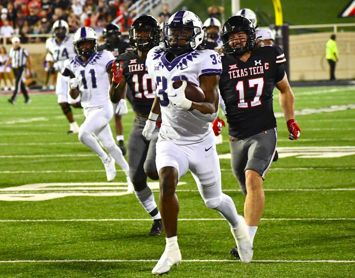 TCU's Kendre Miller races past the Texas Tech defense for a 75-yard touchdown run during their Big 12 conference football game on Saturday in Jones AT&T Stadium at Lubbock.