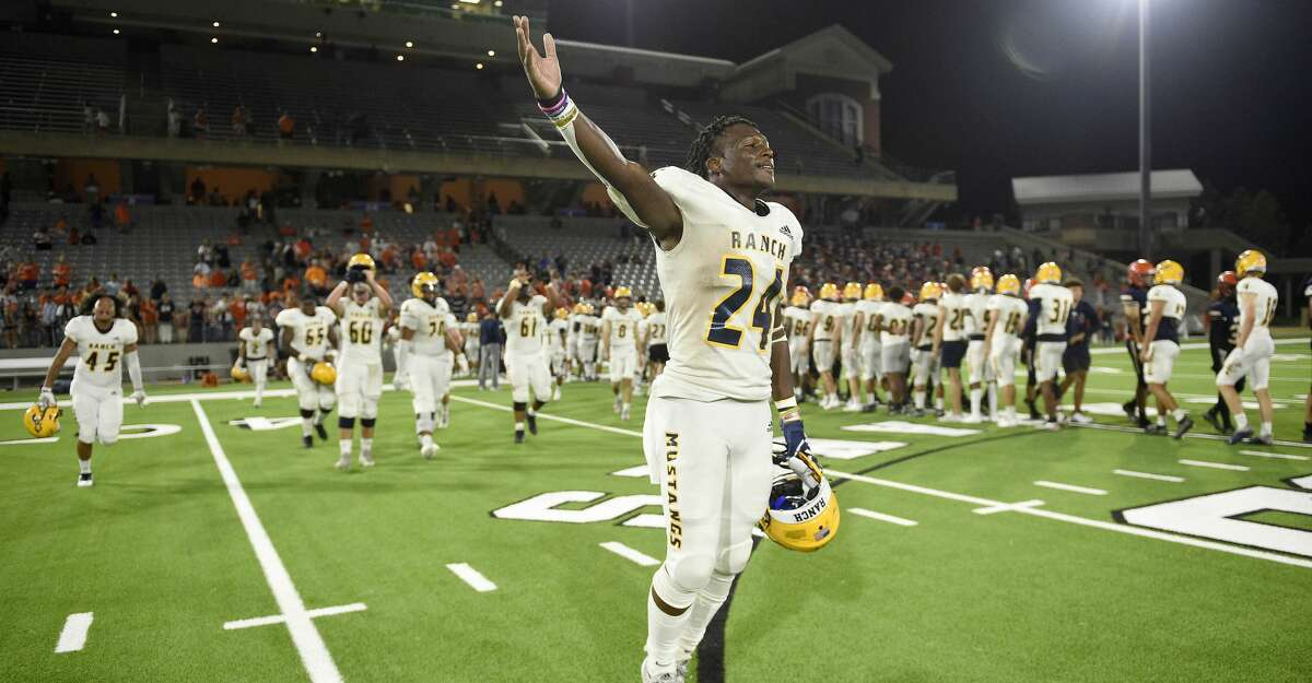 Cypress Ranch running back Kameron Burton (24) celebrates the team's win over Bridgeland in a high school football game, Saturday, Oct. 9, 2021, in Houston.