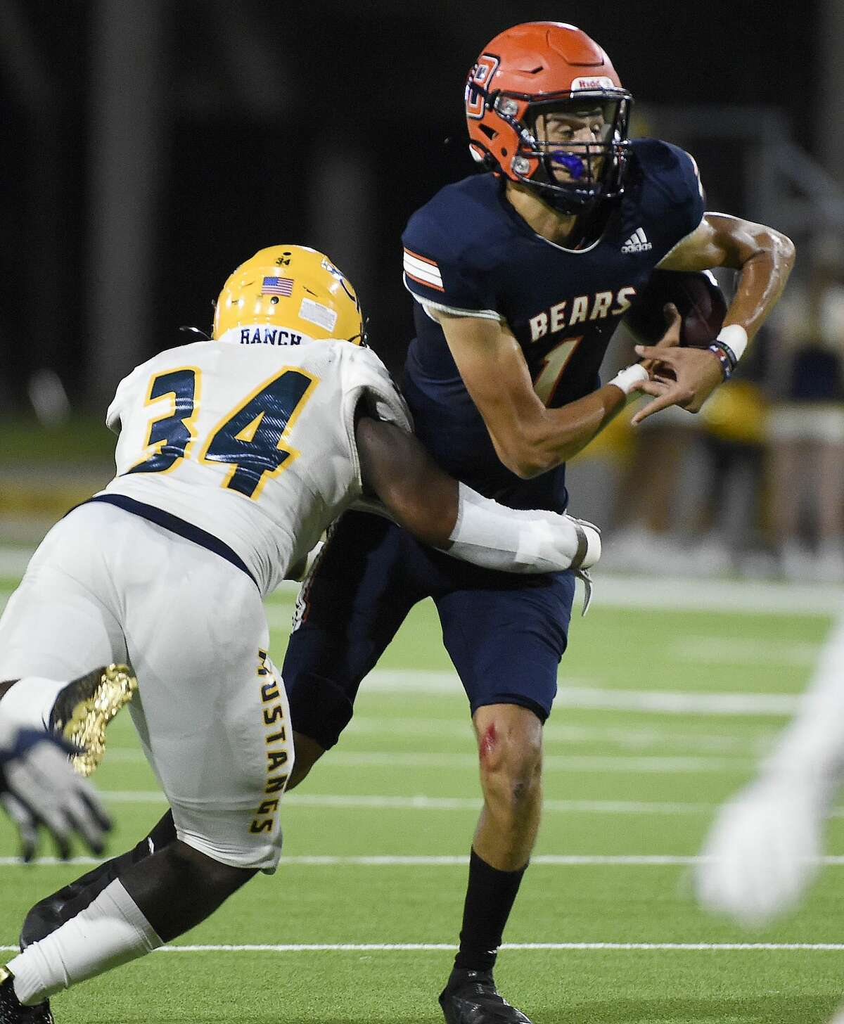 Bridgeland quarterback Josh Stephens (1) fumbles the bal;l after being sacked by Cypress Ranch linebacker Joseph White Jr. during the first half of a high school football game, Saturday, Oct. 9, 2021, in Houston.