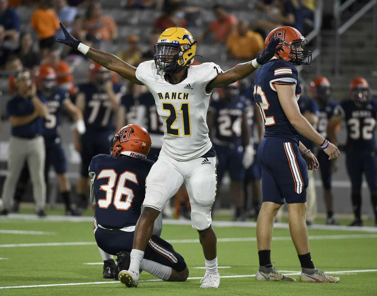 Cy Ranch's Ayden Montgomery (21) celebrates the missed field goal of Bridgeland kicker John Wright, right, during the second half of a high school football game, Saturday, Oct. 9, 2021, in Houston.