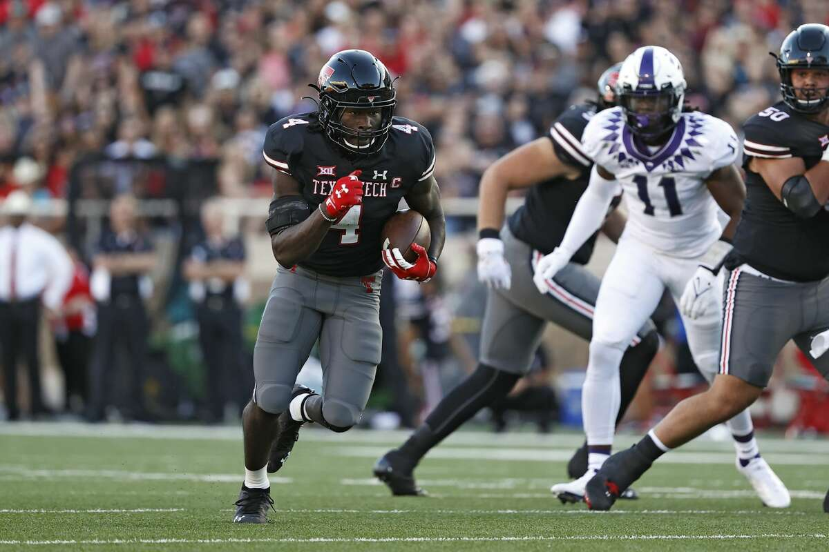 Texas Tech's SaRodorick Thompson (4) runs to score a touchdown during the first half of an NCAAfootball game against TCU, Saturday, Oct. 9, 2021, in Lubbock.