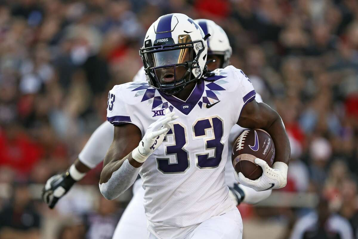 TCU's Kendre Miller (33) runs to score a touchdown during the first half of an NCAAfootball game against Texas Tech, Saturday, Oct. 9, 2021, in Lubbock.