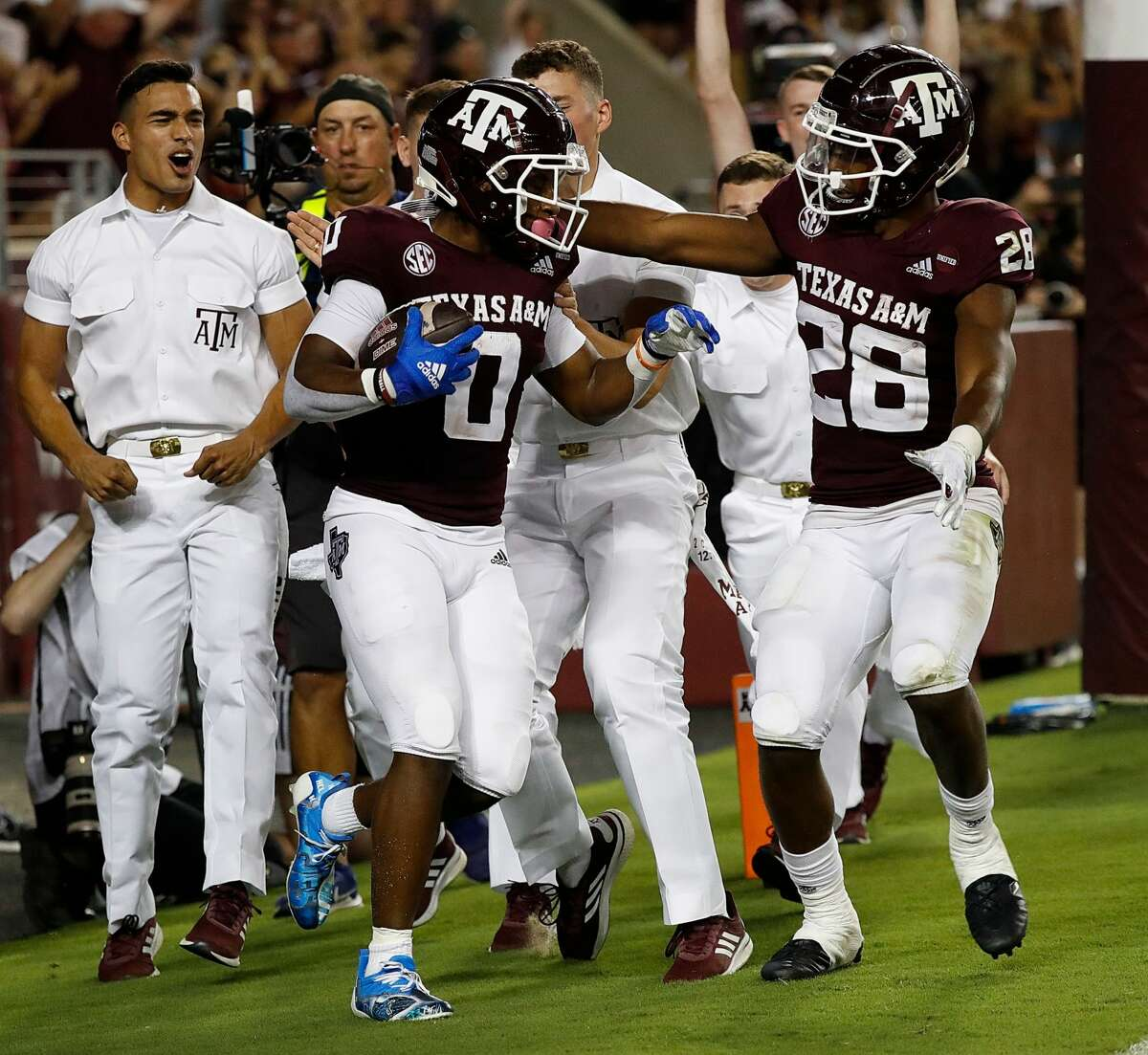 COLLEGE STATION, TEXAS - OCTOBER 09: Ainias Smith #0 of the Texas A&M Aggies celebrates with Isaiah Spiller #28 after catching a 6 yard pass for a touchdown in the first half against the Alabama Crimson Tide at Kyle Field on October 09, 2021 in College Station, Texas. (Photo by Bob Levey/Getty Images)