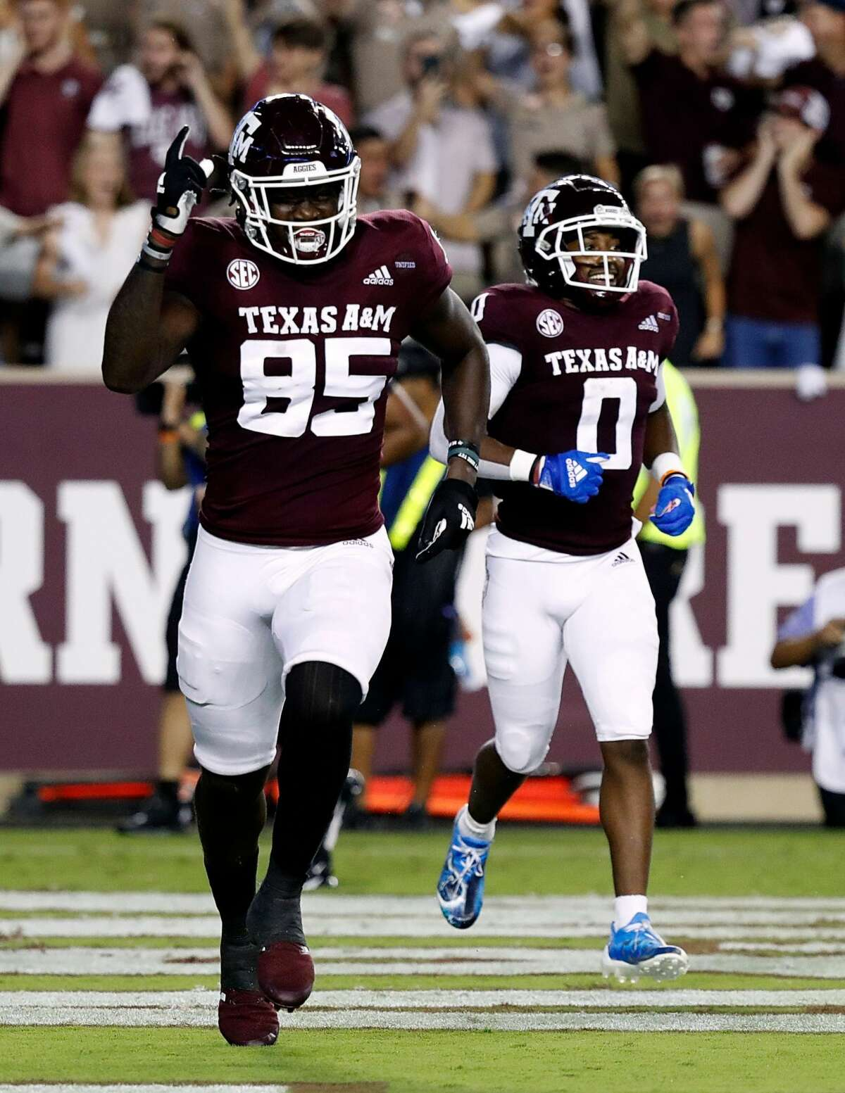 COLLEGE STATION, TEXAS - OCTOBER 09: Jalen Wydermyer #85 of the Texas A&M Aggies and Ainias Smith #0 celebrates a touchdown pass in the first quarter against the Alabama Crimson Tide at Kyle Field on October 09, 2021 in College Station, Texas. (Photo by Bob Levey/Getty Images)