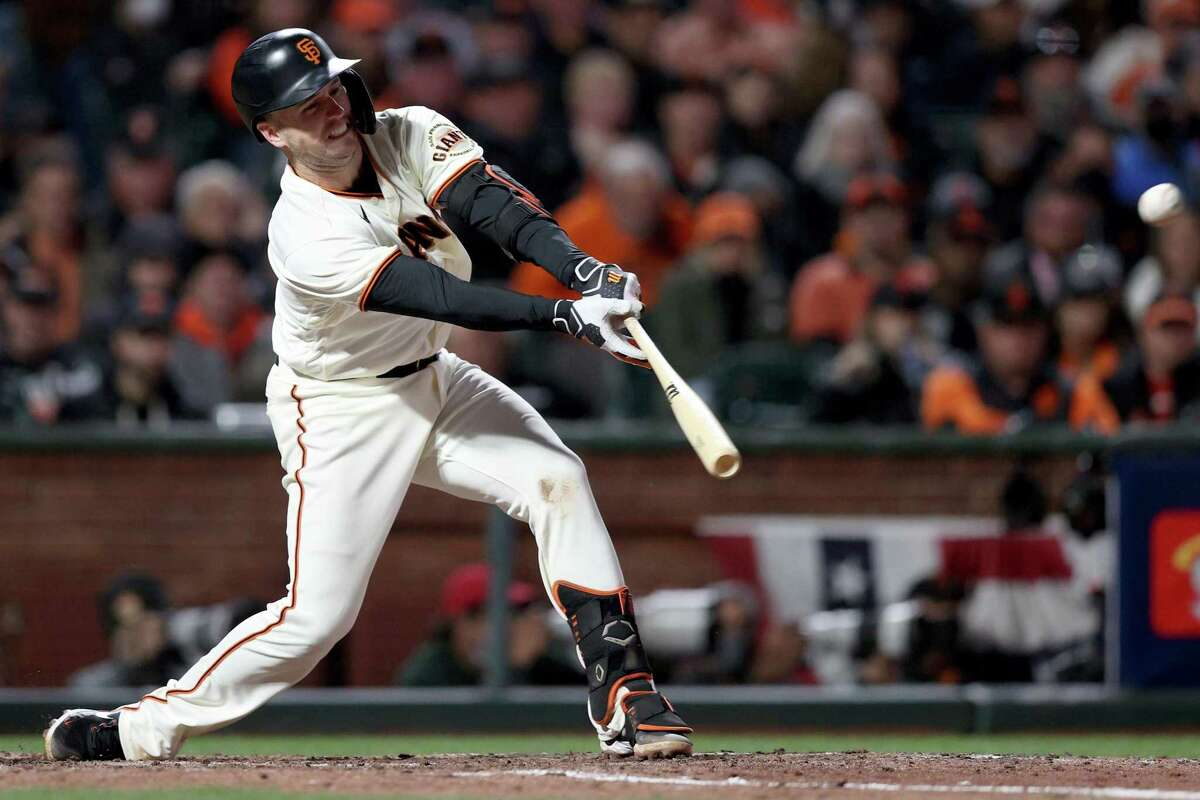 SAN FRANCISCO, CALIFORNIA - OCTOBER 09: Buster Posey #28 of the San Francisco Giants hits a single in the sixth inning against the Los Angeles Dodgers during Game 2 of the National League Division Series at Oracle Park on October 09, 2021 in San Francisco, California. (Photo by Ezra Shaw/Getty Images)