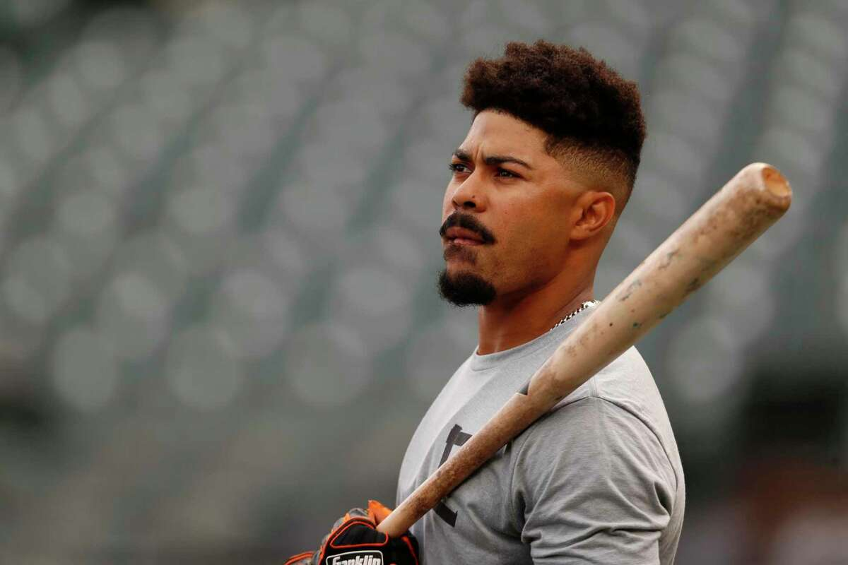 San Francisco Giants' LaMonte Wade Jr. takes batting practice during a workout prior to Game 1 of a baseball National League Division Series against the Los Angeles Dodgers, Thursday, Oct. 7, 2021, in San Francisco. (AP Photo/Jed Jacobsohn)
