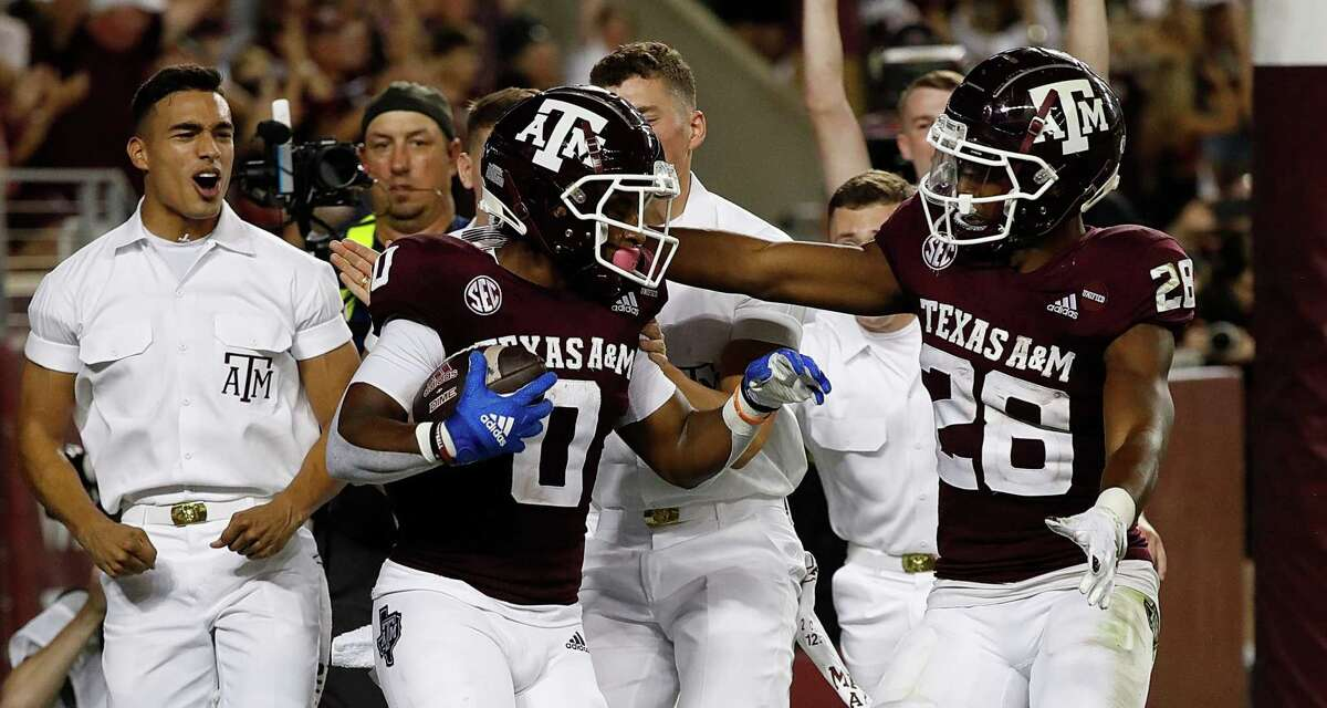 Ainias Smith and Isaiah Spiller celebrate an early touchdown against Alabama.