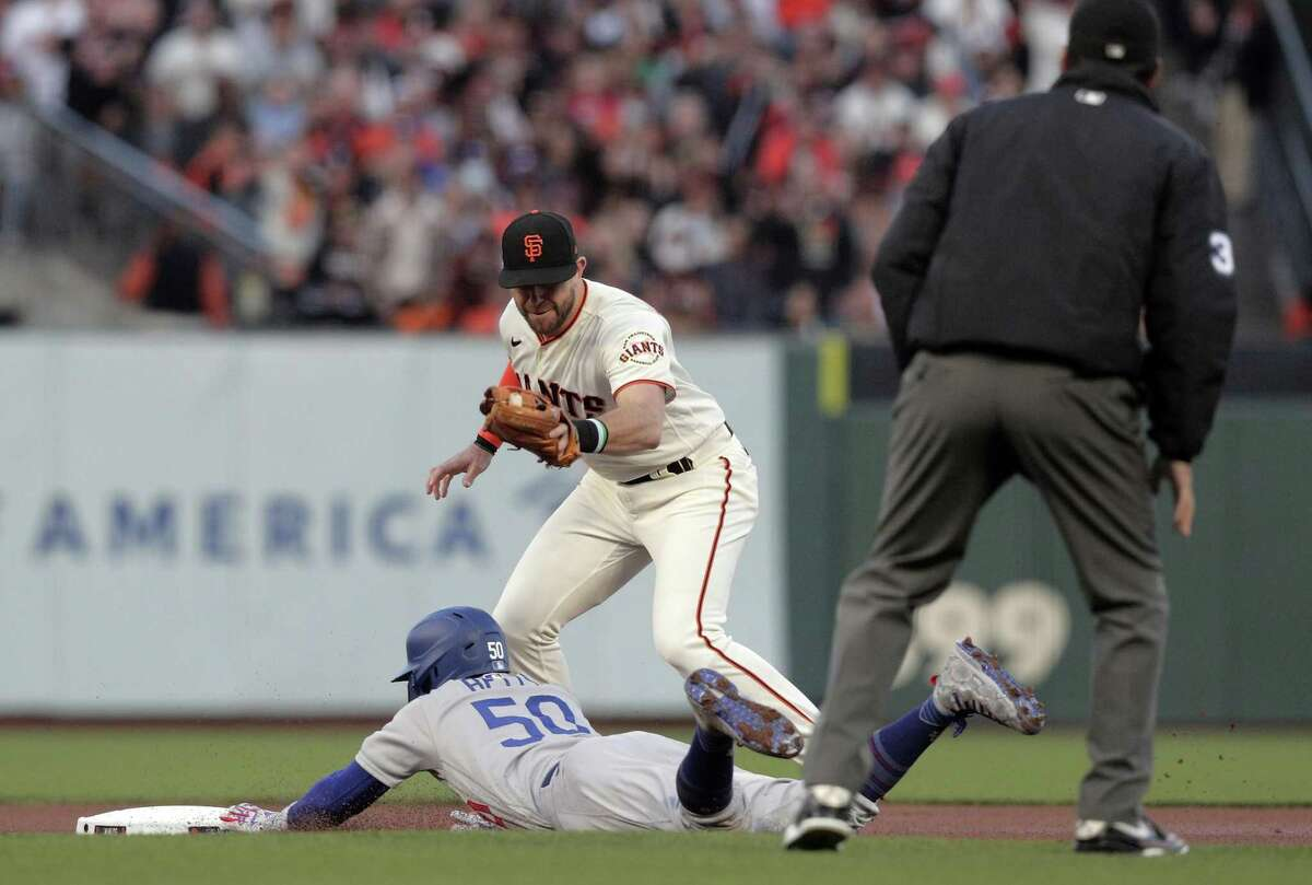 Mookie Betts (50) steals second in the first inning as the San Francisco Giants played the Los Angeles Dodgers in Game 2 of the National League Division Series at Oracle Park in San Francisco, Calif., on Saturday, October 9, 2021.