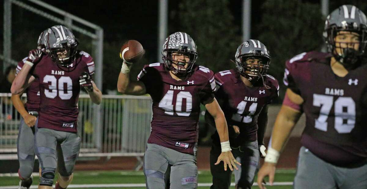 Marshall Noah Garza celebrates an interception in the fourth quarter ending a Homes drives. Marshall defeated Holmes 26-16 on Saturday, Oct. 9, 2021.