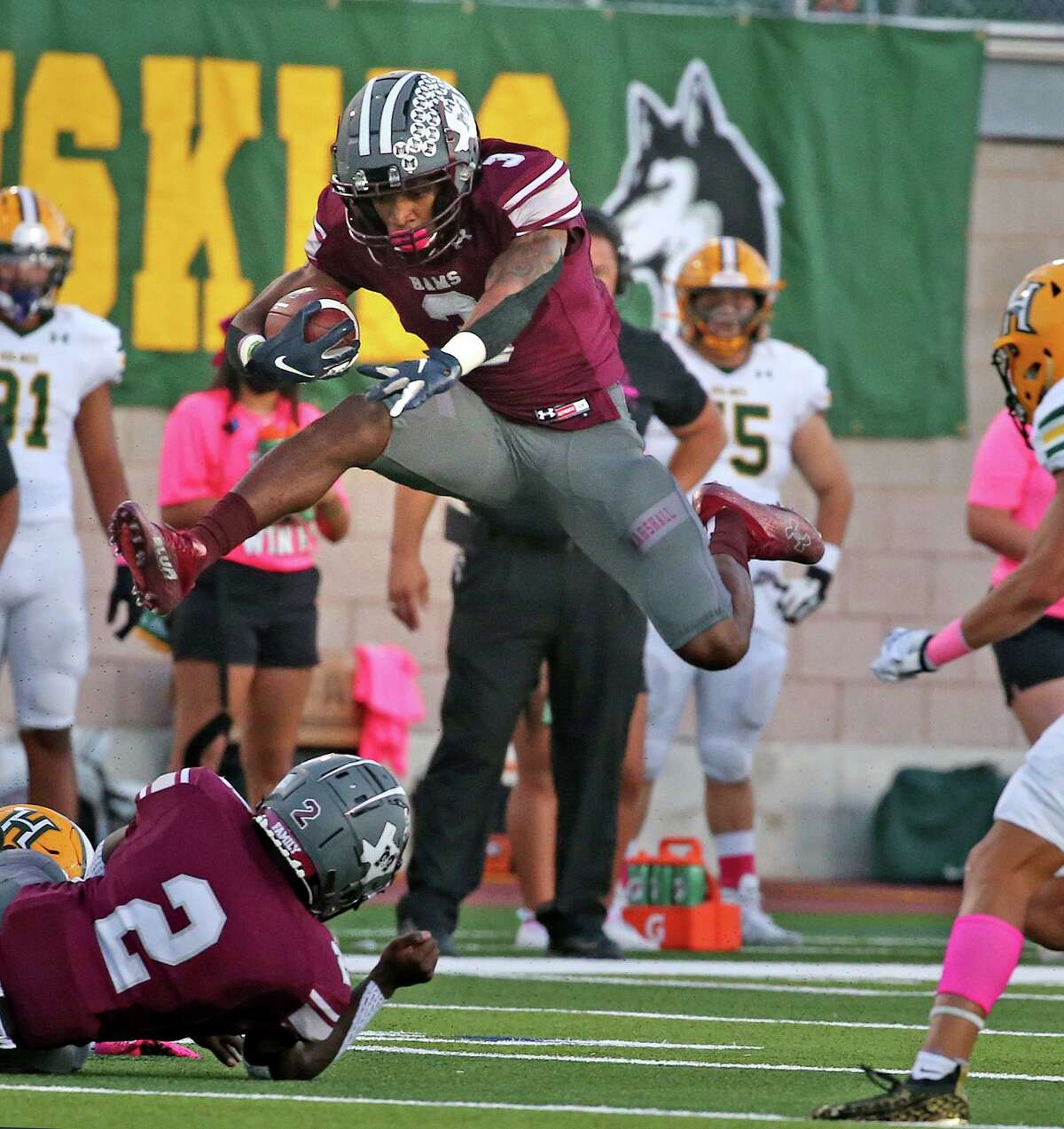 Marshall wide receiver Tre'vion Butler (3) leaps over would be Holmes defenders in first quarter. Halftime score Marshall 23 Holmes 0 on Saturday, Oct. 9, 2021.