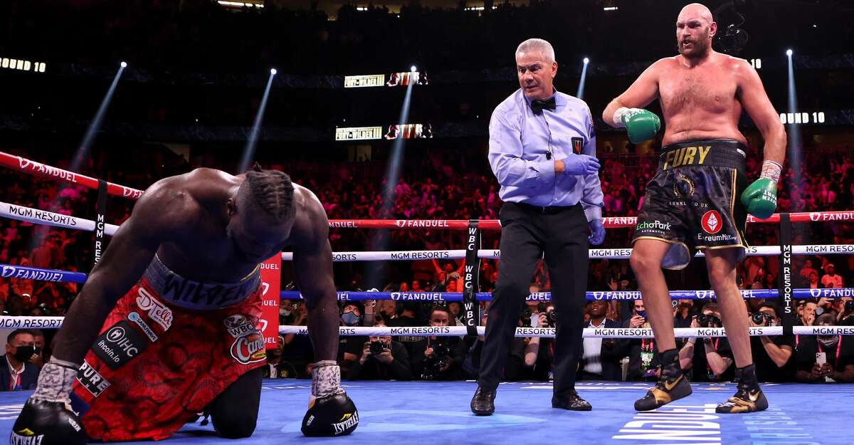 Tyson Fury (R) reacts after knocking down Deontay Wilder during their WBC heavyweight title fight at T-Mobile Arena on October 09, 2021 in Las Vegas, Nevada. (Photo by Al Bello/Getty Images)