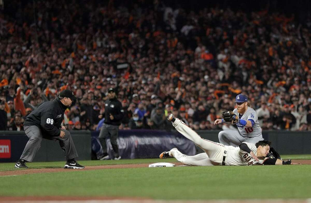 Wilmer Flores (41) out at third base after being tagged by Justin Turner (10) in the sixth inning as the San Francisco Giants played the Los Angeles Dodgers in Game 2 of the National League Division Series at Oracle Park in San Francisco, Calif., on Saturday, October 9, 2021.