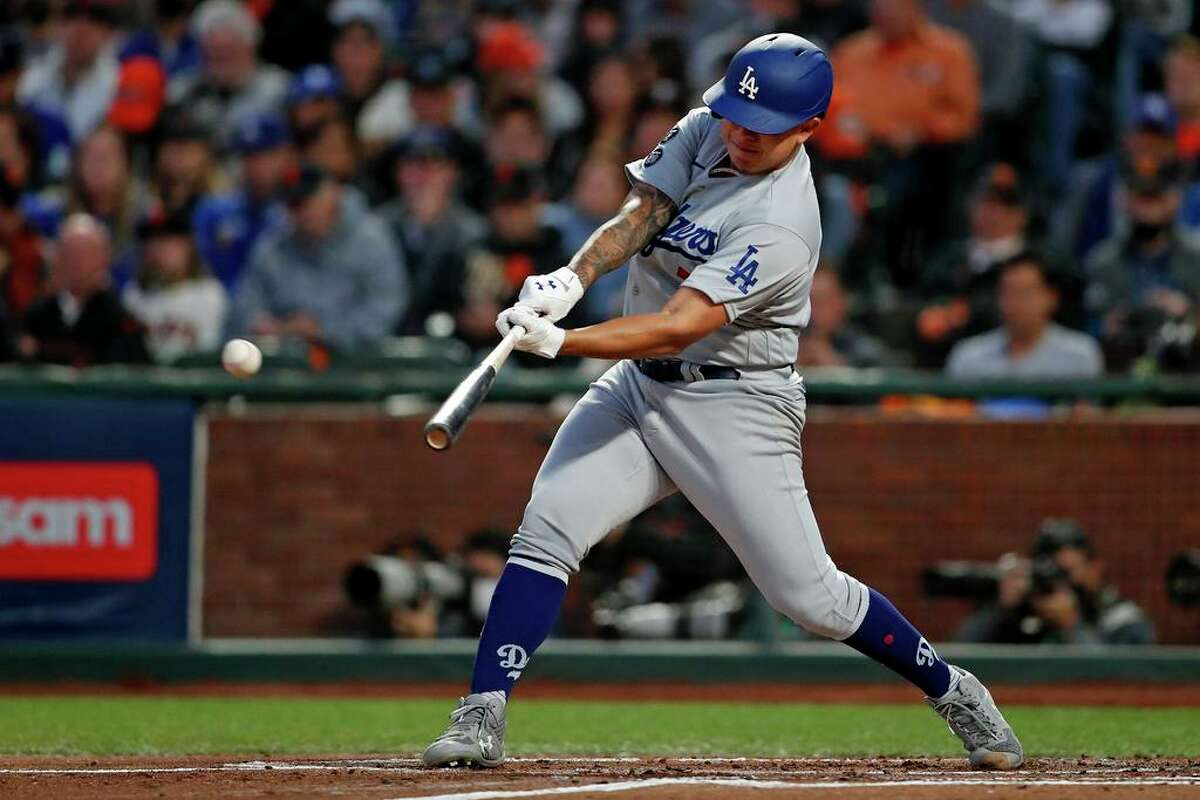 Los Angeles Dodgers' pitcher Julio Urias hits an RBI single in 2nd inning against San Francisco Giants' Kevin Gausman during National League Division Series Game 2 at Oracle Park in San Francisco, Calif., on Saturday, October 9, 2021