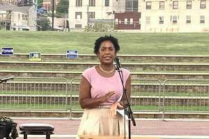 Illinois Lt. Gov. Juliana Stratton speaks at the Liberty Bank Amphitheater in Alton during the Madison County Democrat's annual fundraiser JFK event Saturday.