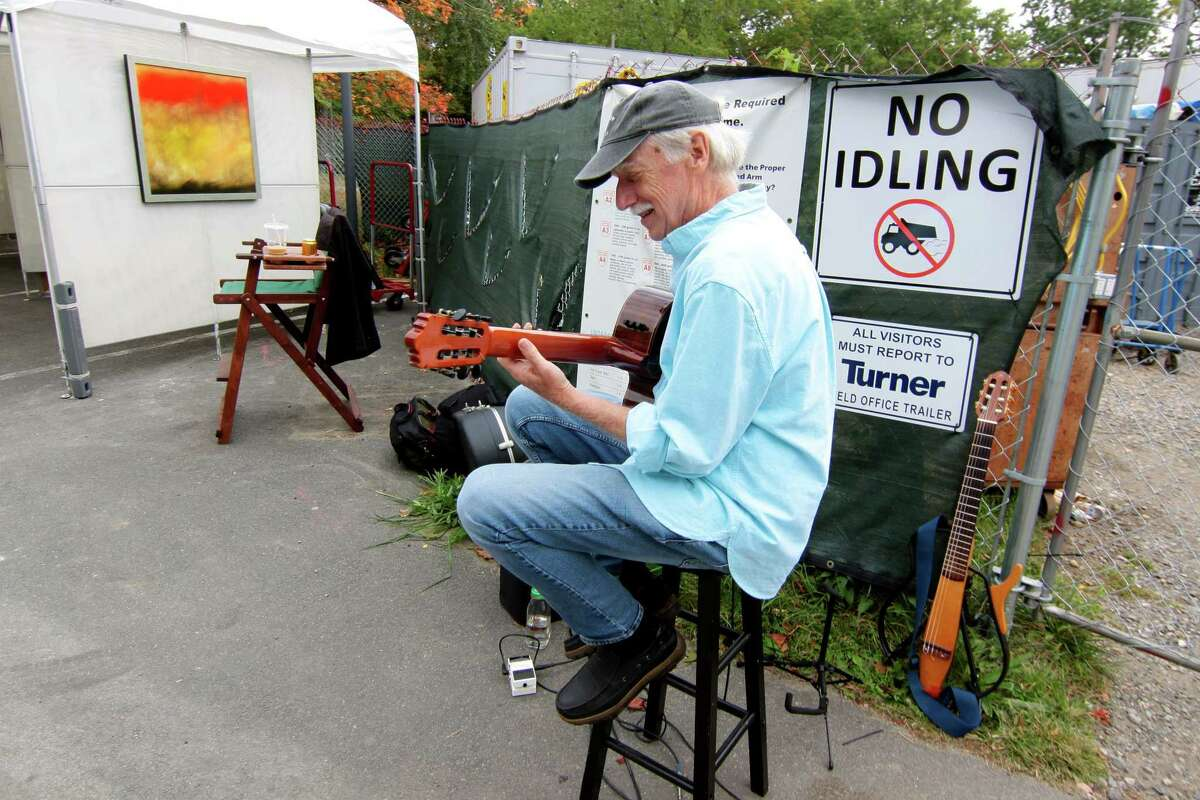 Musician Ed Wright entertains festival goers during Bruce Museum's 40th annual outdoor Art Festival held on the museum grounds in Greenwich, Conn., on Saturday October 9, 2021. The festival features original work by artists and craftspeople from around the country. All artists attend in person, and all works are for sale. The hours are 10 a.m. to 5 p.m. on Sunday. Tickets are available at BruceMuseum.org.