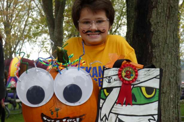 This youngster shows his award winning jack-o-lantern at the Fall Festival pumpkin carving contest in Onekama this weekend.
