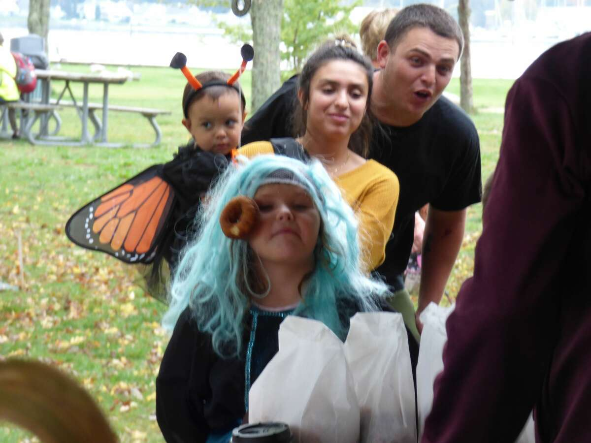 Kids in costume enjoy activities at the annual Fall Festival in Onekama on Saturday.