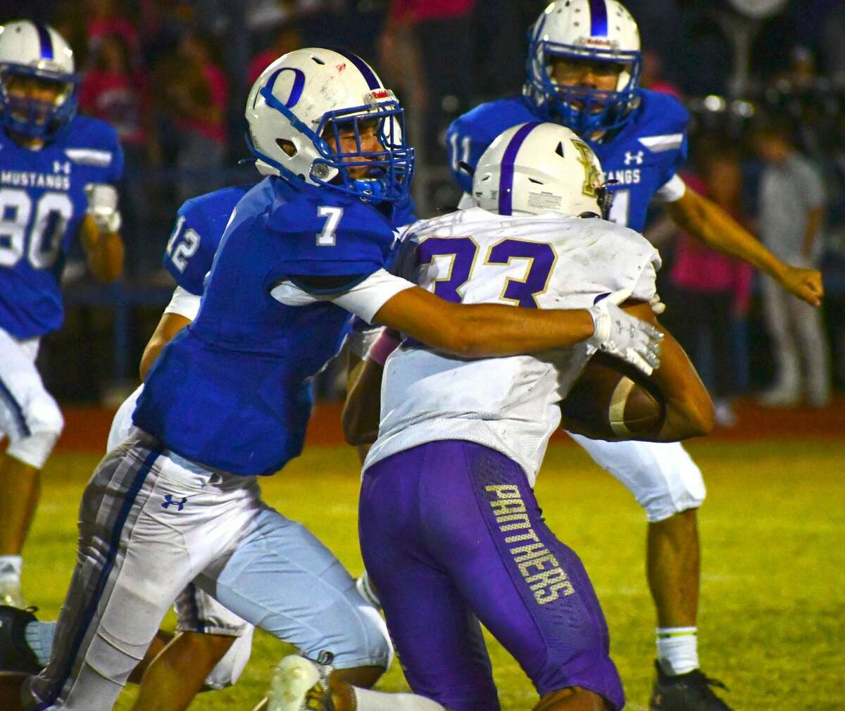 Olton's Andrew Martinez attempts to tackle Panhandle ball carrier Malachi Preston.
