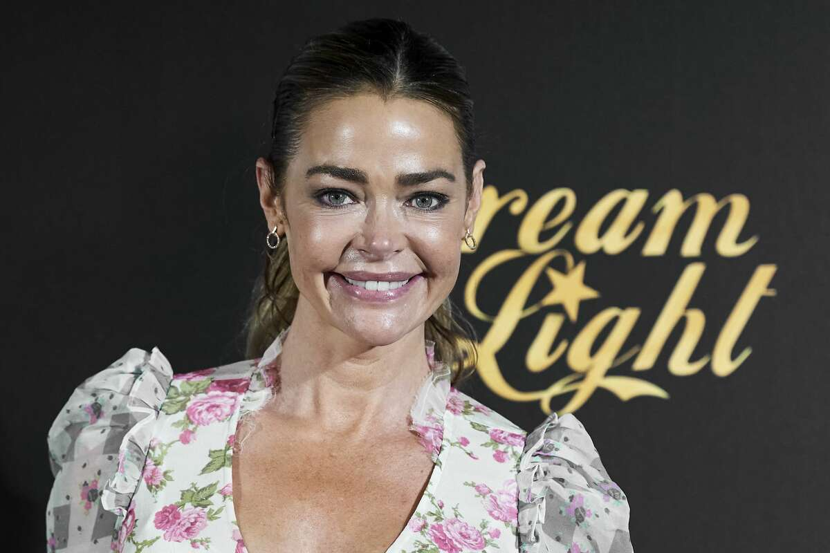 """Actress Denise Richards attends """"Glow & Darkness"""" photocall at the Palace Hotel on October 26, 2020 in Madrid, Spain."""