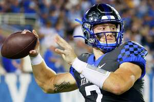 Kentucky quarterback Will Levis warms up during the first half of an NCAA college football game against LSU in Lexington, Ky., Saturday.