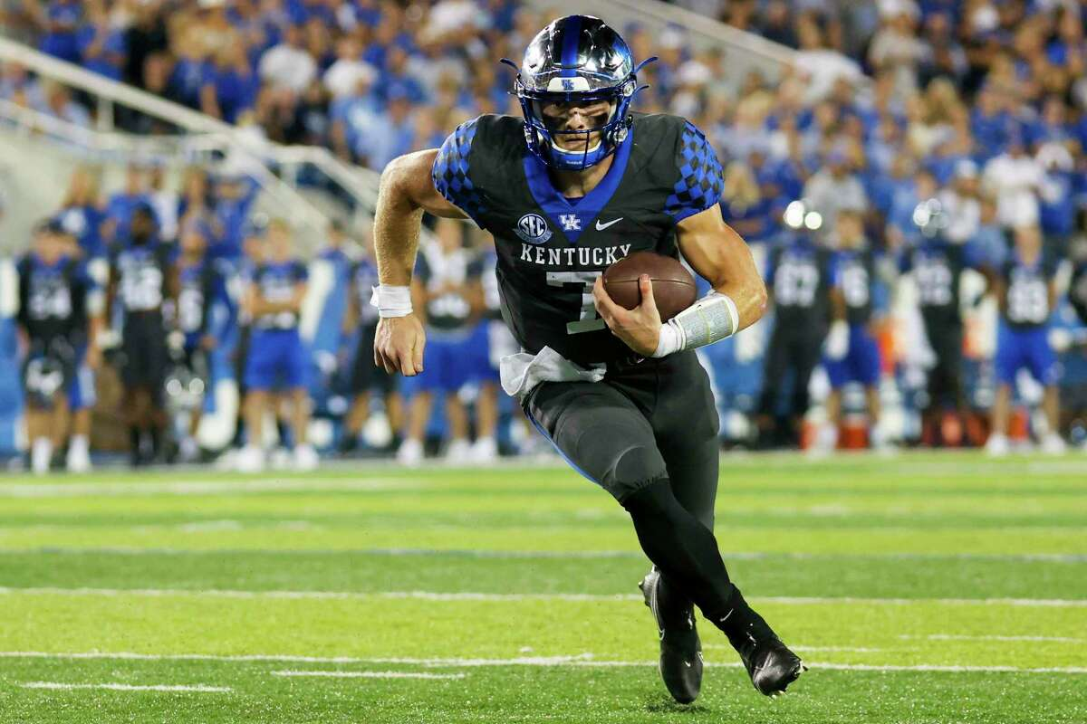 Kentucky quarterback Will Levis runs the ball into the end zone for a touchdown during the second half of the team's NCAA college football game against LSU in Lexington, Ky., Saturday.