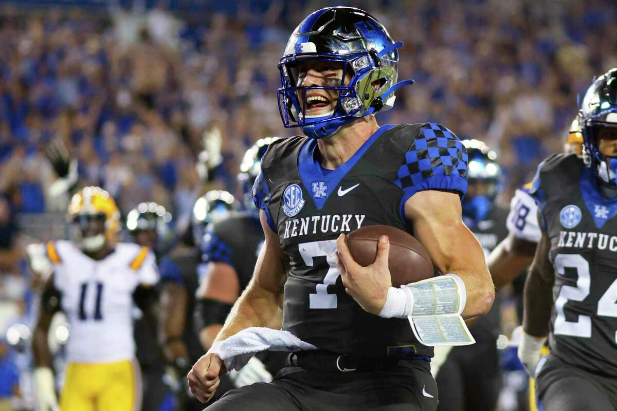 Kentucky quarterback Will Levis smiles as he scores a touchdown during the second half of the team's NCAA college football game against LSU in Lexington, Ky., Saturday.