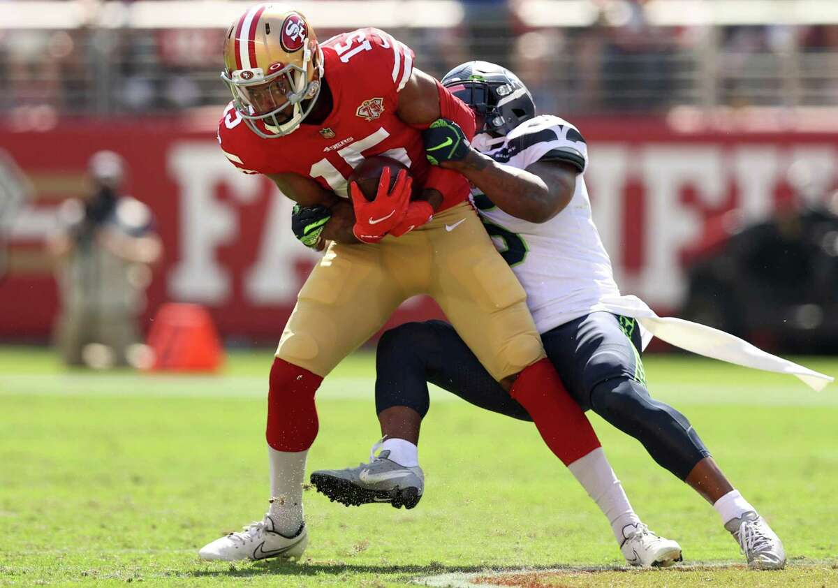 SANTA CLARA, CALIFORNIA - OCTOBER 03: Jauan Jennings #15 of the San Francisco 49ers catches the ball during the first half against the Seattle Seahawks at Levi's Stadium on October 03, 2021 in Santa Clara, California. (Photo by Ezra Shaw/Getty Images)