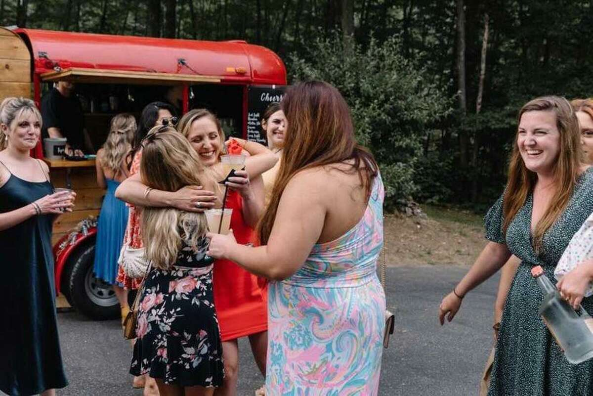 Wedding guests greet each other near Mix & Mingle Mobile Bar.