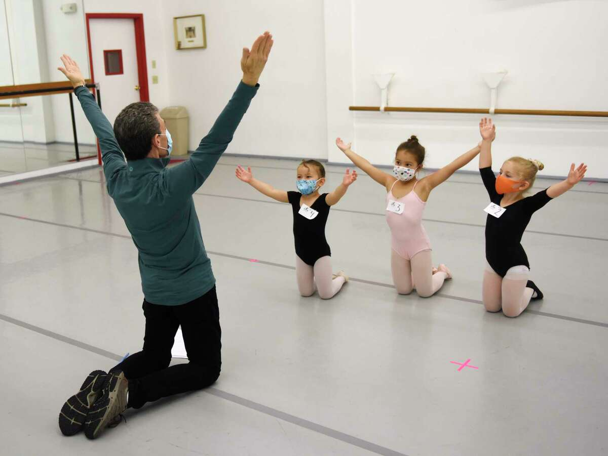 """Artistic Director and Founder Brett Raphael leads four-year-olds Isla McBeth, Karina Michalczyk, and Sophie Micewicz through auditions for """"The Nutcracker"""" at Connecticut Ballet in Stamford, Conn. Sunday, Oct. 10, 2021. After a two year hiatus due to COVID, """"The Nutcracker"""" will return this year with performances on Dec. 18 and 19 at The Palace in Stamford."""