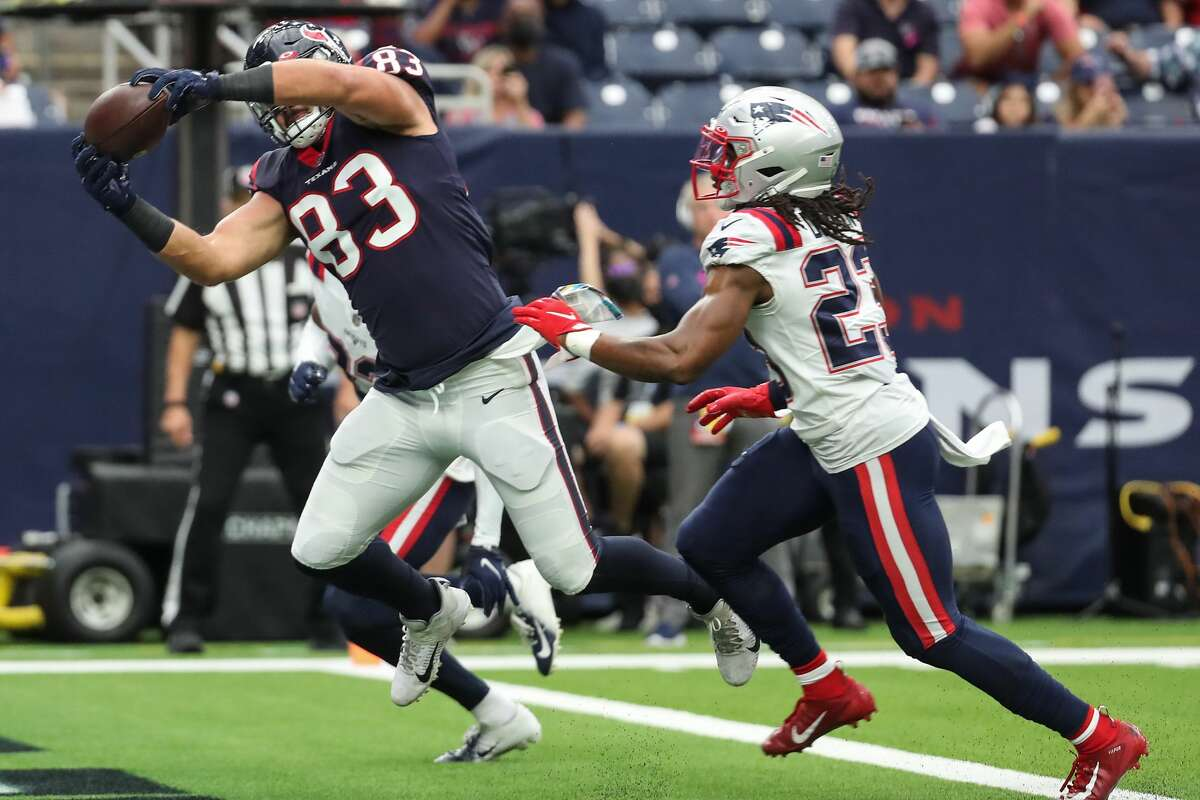 Houston Texans tight end Antony Auclair (83) hauls in an 11-yard touchdown reception against New England Patriots safety Kyle Dugger (23) during the first half of an NFL football game Sunday, Oct. 10, 2021, in Houston.