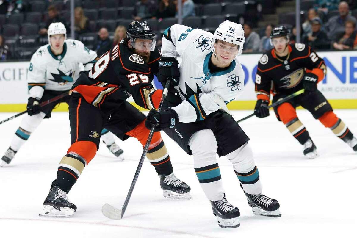 William Eklund, the Sharks' top draft pick in July, battles Anaheim's Greg Pateryn (29) for the puck last month.