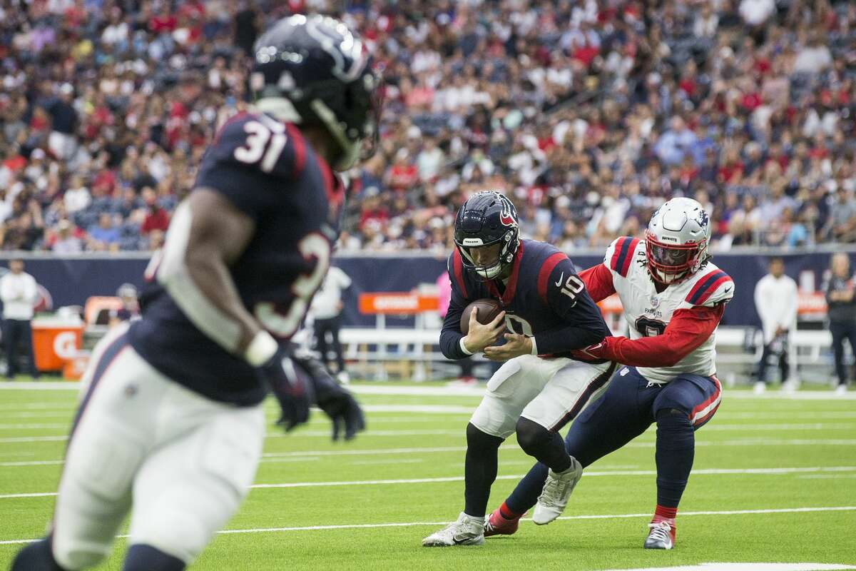 Houston Texans quarterback Davis Mills (10) is sacked by New England Patriots linebacker Matt Judon (9) during the first half of an NFL football game Sunday, Oct. 10, 2021, in Houston.