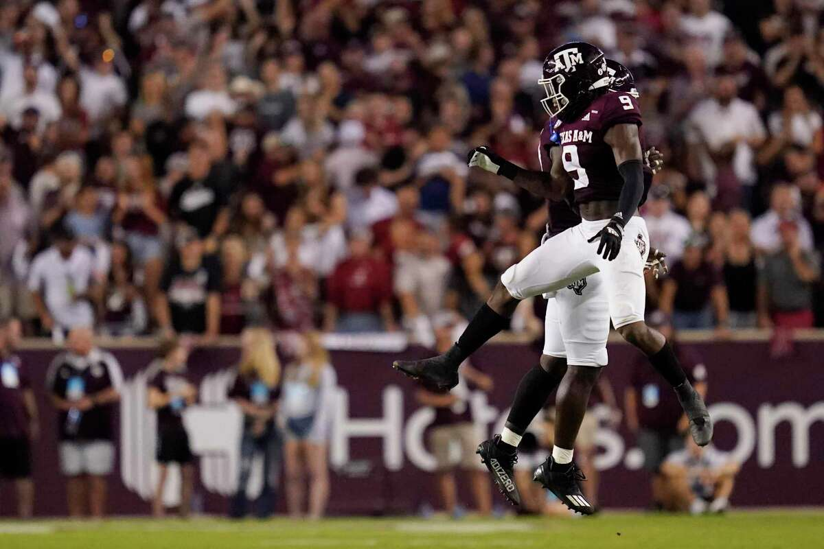 Texas A&M defensive lineman Tyree Johnson and defensive back Leon O'Neal Jr. (9) celebrate after Johnson sacked Alabama quarterback Bryce Young during the first half of an NCAA college football game Saturday, Oct. 9, 2021, in College Station, Texas. (AP Photo/Sam Craft)