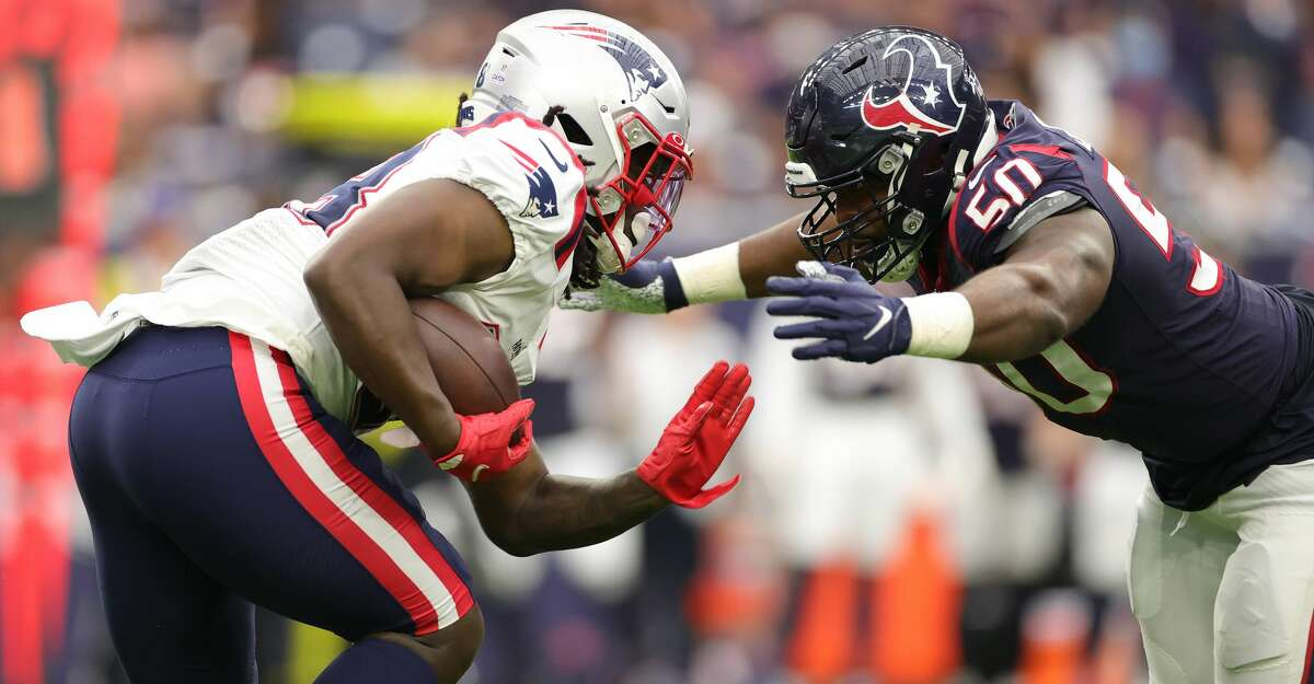 Rhamondre Stevenson #38 of the New England Patriots is tacked by Jordan Jenkins #50 of the Houston Texans during the second half at NRG Stadium on October 10, 2021 in Houston, Texas. (Photo by Carmen Mandato/Getty Images)