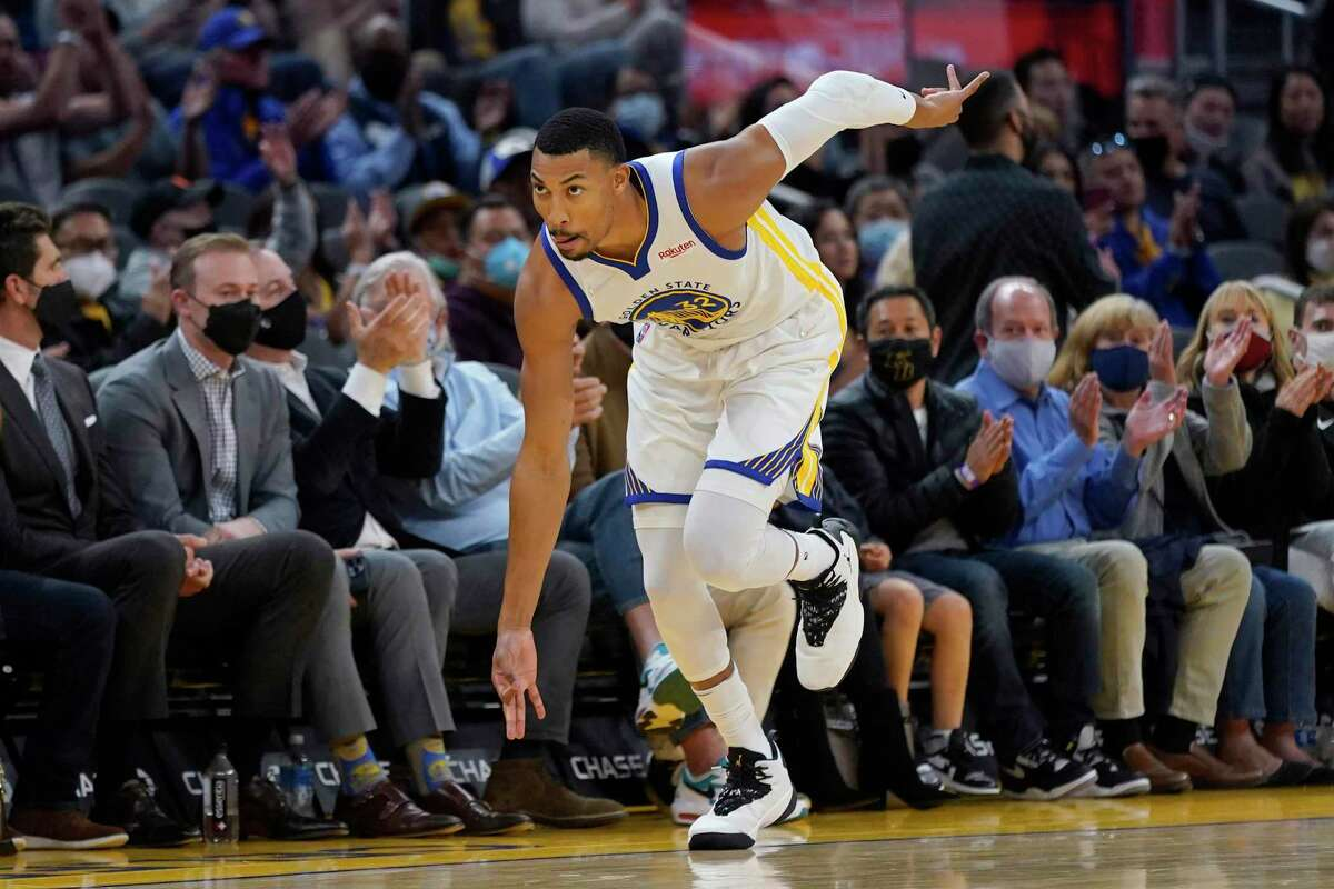 Golden State Warriors forward Otto Porter Jr. celebrates after scoring a 3-point basket against the Denver Nuggets during the first half of a preseason NBA basketball game in San Francisco, Wednesday, Oct. 6, 2021. (AP Photo/Jeff Chiu)