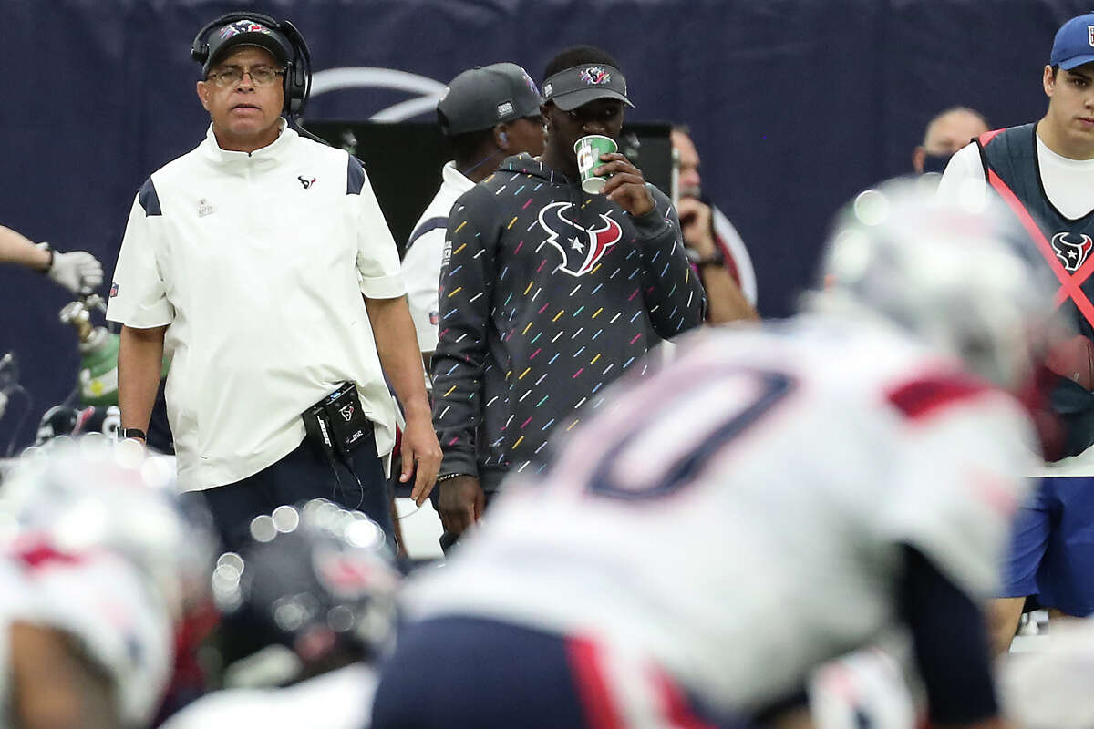 Houston Texans head coach David Culley watches New England Patriots quarterback Mac Jones (10) line up under center during the first half of an NFL football game Sunday, Oct. 10, 2021, in Houston.
