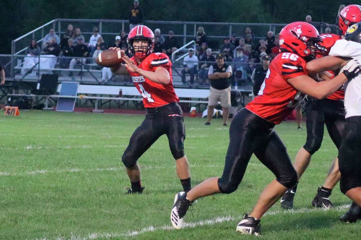Benzie Central's Ike Koscielski drops back to pass during a game earlier this season. (File photo)