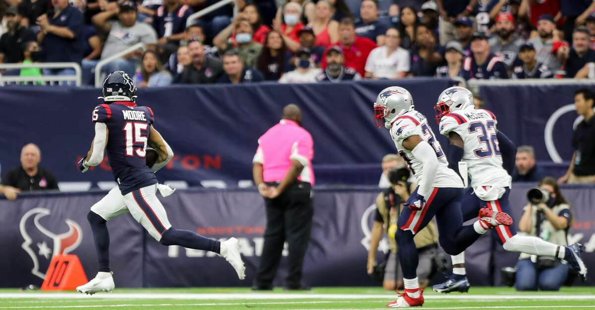 Houston Texans wide receiver Chris Moore (15) scores a 67-yard receiving touchdown against the New England Patriots during the second quarter of an NFL football game at NRG Stadium on Sunday, Oct. 10, 2021, in Houston. The Patriots won 25-22.