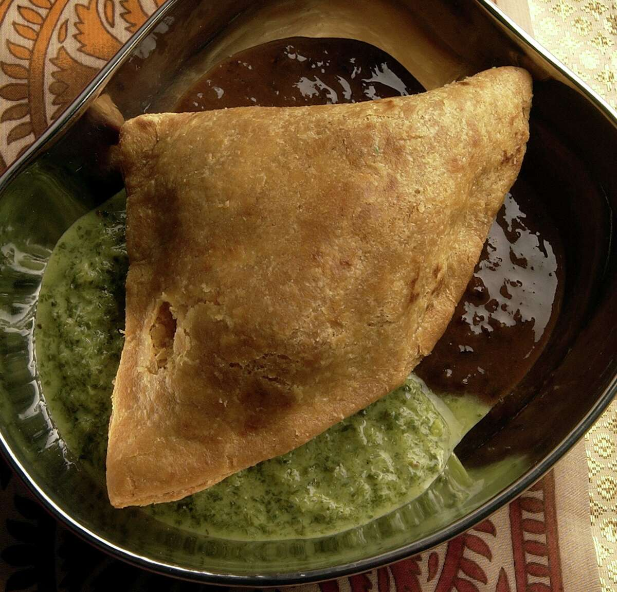 Chaat, or Indian snack foods, are typically served with cilantro-mint and tamarind chutneys.