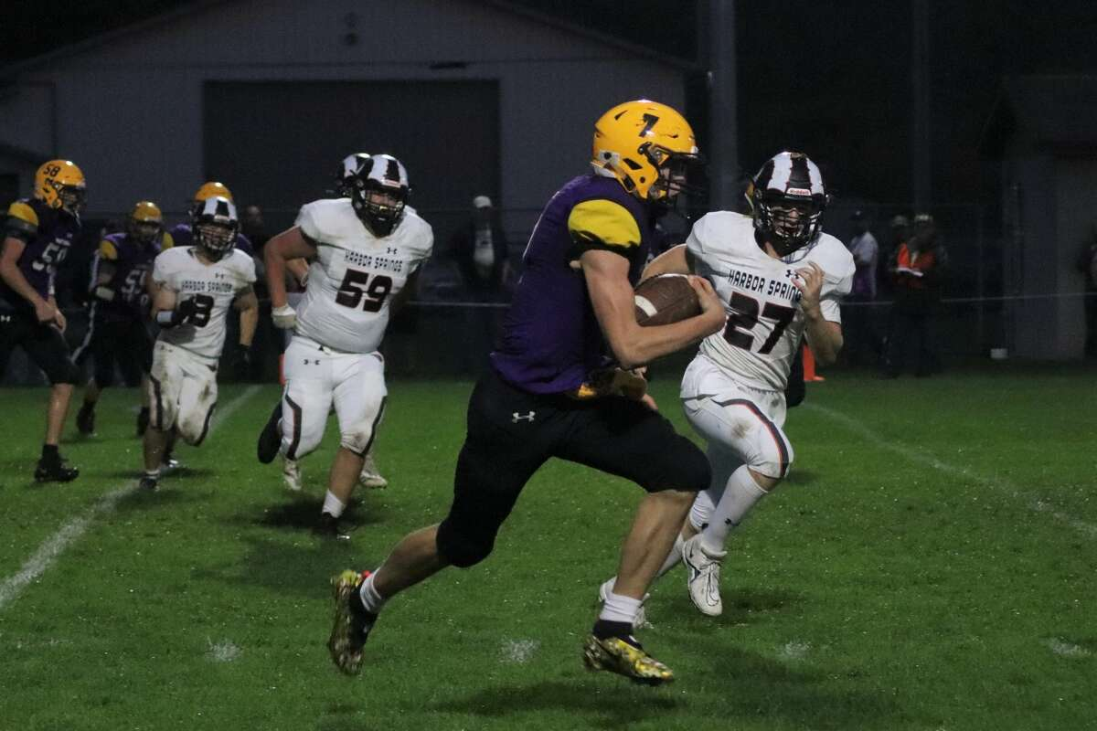 Nick Stevenson carries the ball on a quarterback keeper against Harbor Springs on Oct. 8.