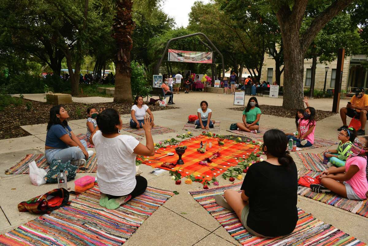 Madelein Santibanez leads a Circle in the Hood Healing Circle during the International Girls Day in Alamo City on Sunday afternoon at Yanaguana Garden.