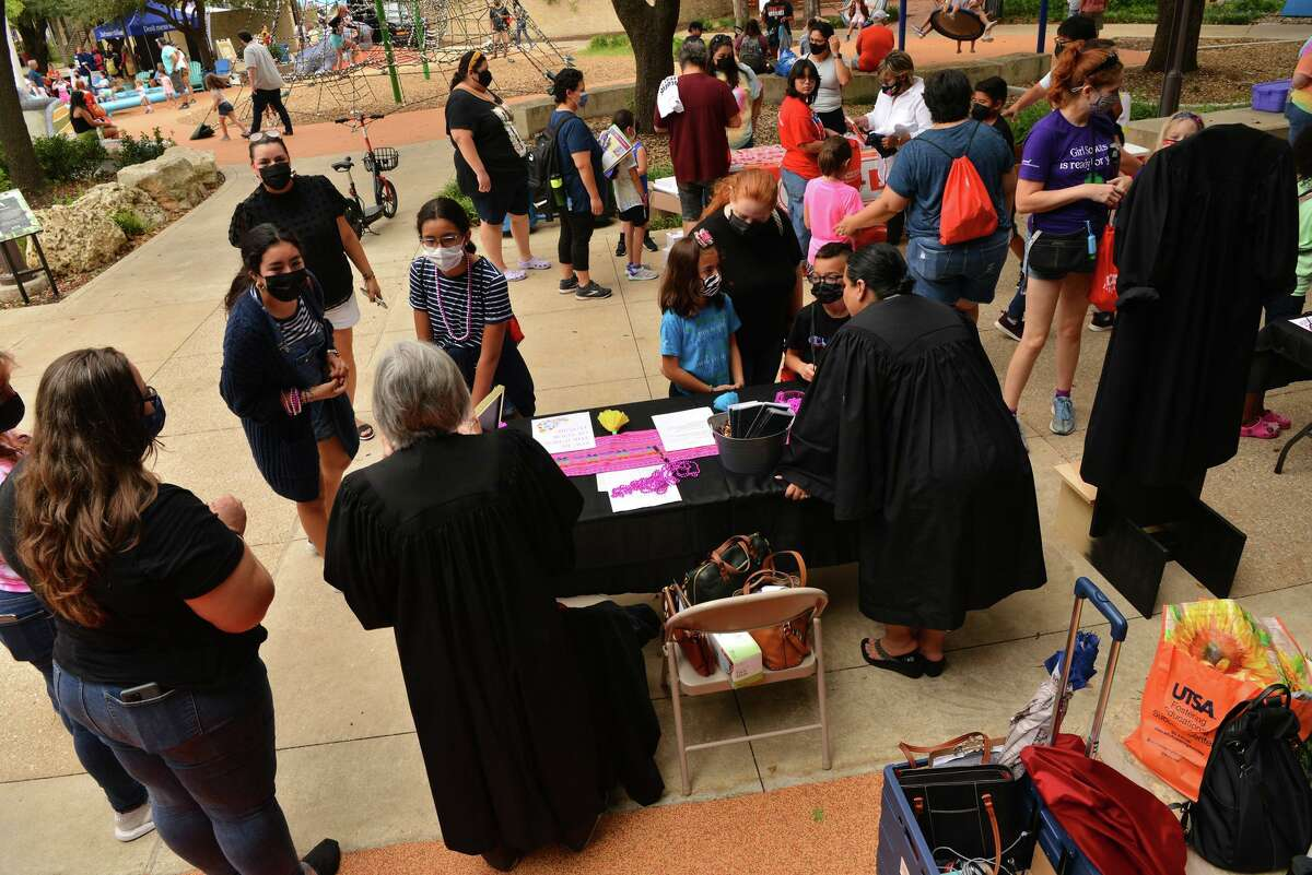 Judges talk with interested youngsters during the International Day of the Girl in the Alamo City on Sunday afternoon at Yanaguana Garden.