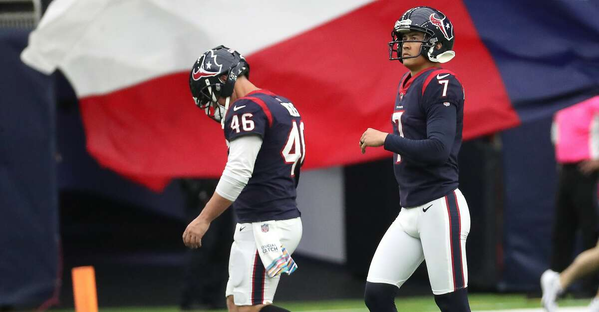 Houston Texans long snapper Jon Weeks (46) and place kicker Ka'imi Fairbairn (7) walk off the field after Fairbairn missed his second extra point attempt of the game against the New England Patriots during the first half of an NFL football game Sunday, Oct. 10, 2021, in Houston.