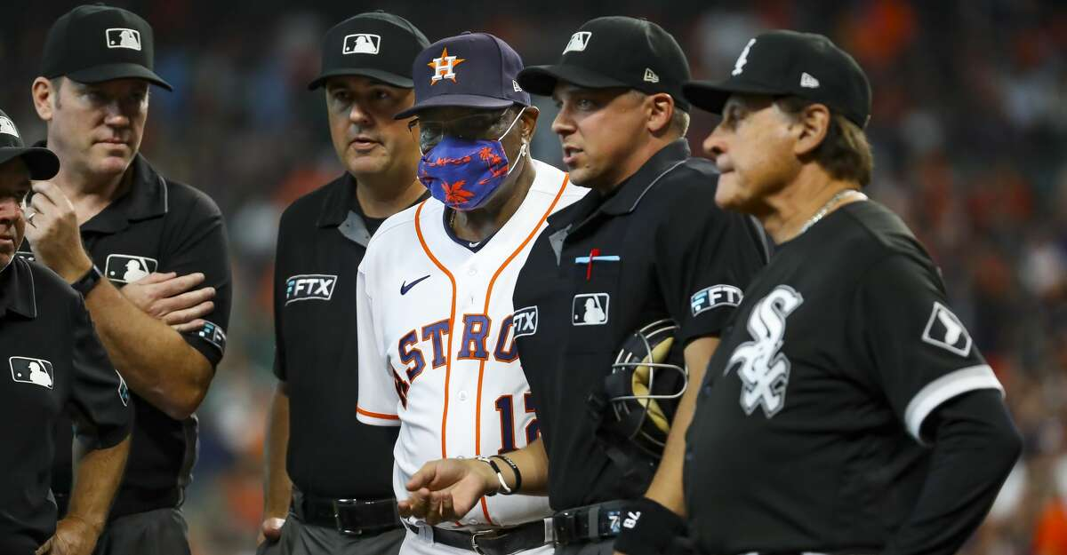 Houston Astros manager Dusty Baker Jr. (12) and Chicago White Sox manager Tony La Russa (22) meet with the umpires before Game 1 of the AL Division Series Thursday, Oct. 7, 2021, in Houston.