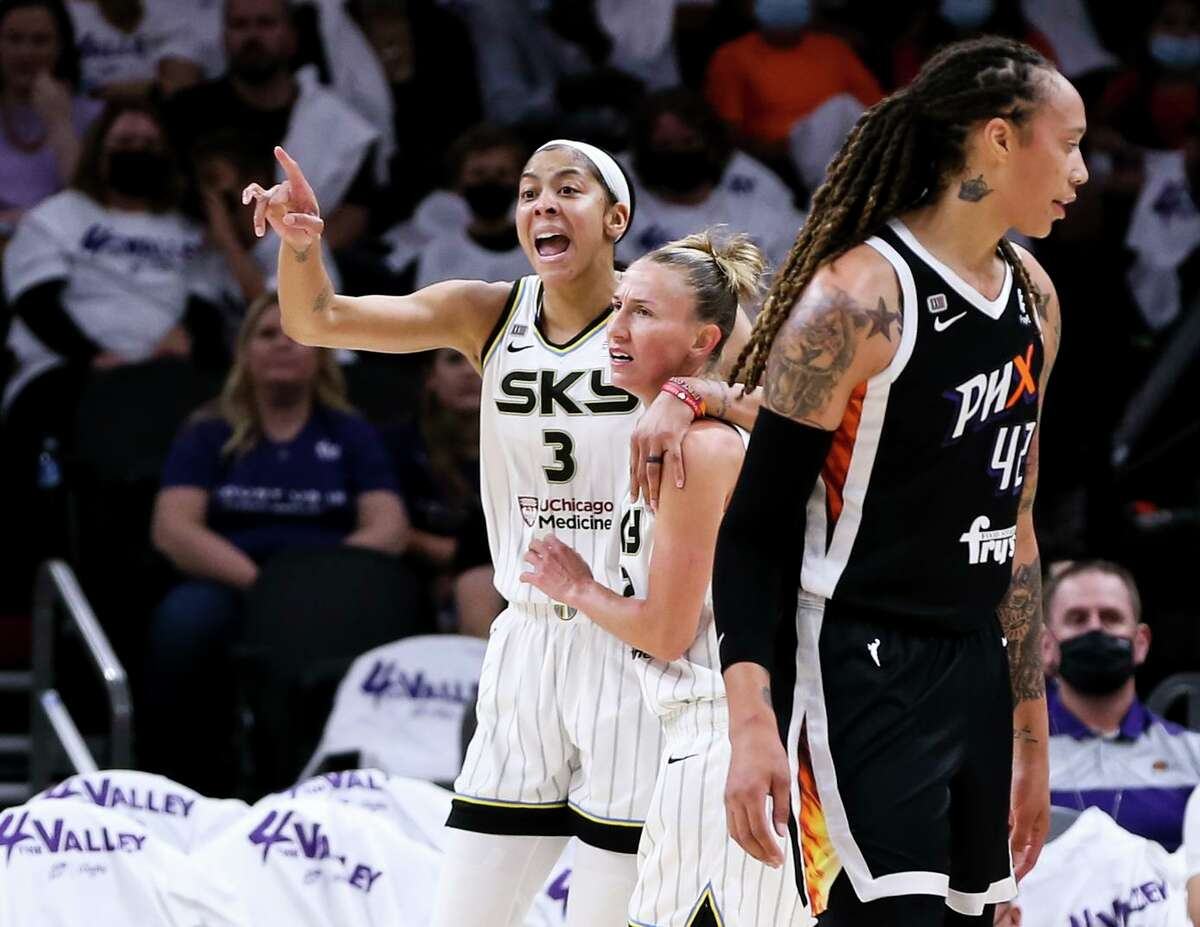 Chicago's Candace Parker (3), who scored 16 points, and teammate Courtney Vandersloot react to a second-half play during a win at Phoenix in Game 1 of the WNBA Finals.