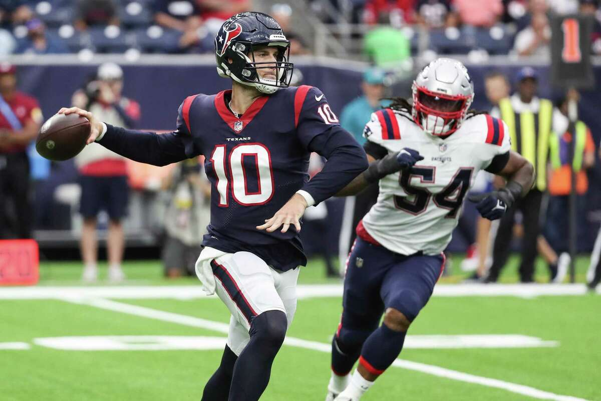 Houston Texans quarterback Davis Mills (10) rolls out to pass against the New England Patriots during the first half of an NFL football game Sunday, Oct. 10, 2021, in Houston.