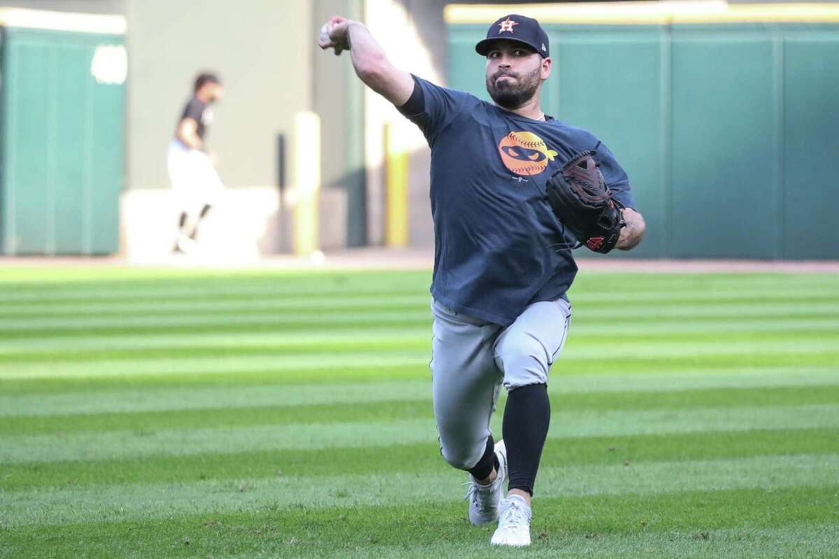 Houston Astros starting pitcher Jose Urquidy works out in the outfield before Game 3 of the American League Division Series Sunday, Oct. 10, 2021, in Chicago.