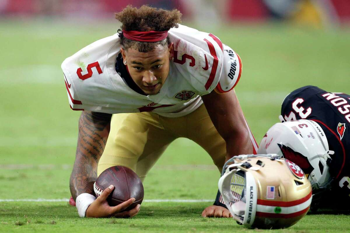 San Francisco 49ers quarterback Trey Lance (5) is tackled by Arizona Cardinals free safety Jalen Thompson (34) during the second half of an NFL football game, Sunday, Oct. 10, 2021, in Glendale, Ariz. (AP Photo/Ralph Freso)