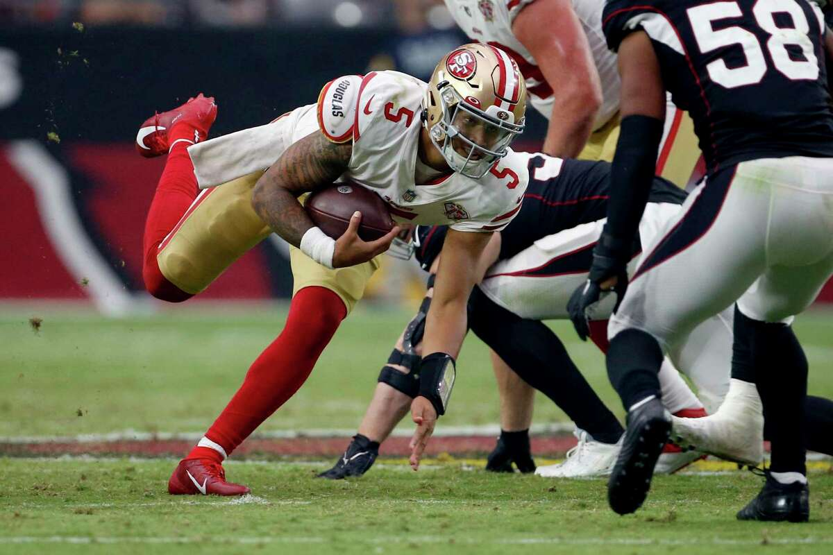 San Francisco 49ers quarterback Trey Lance (5) scrambles against the Arizona Cardinals during the second half of an NFL football game, Sunday, Oct. 10, 2021, in Glendale, Ariz. (AP Photo/Ralph Freso)