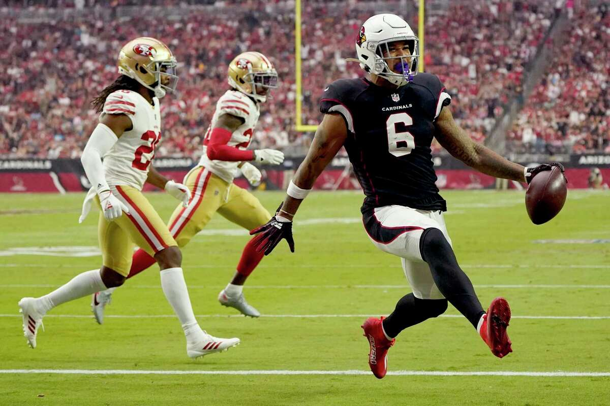 Arizona Cardinals running back James Conner (6) scores a touchdown against the San Francisco 49ers during the first half of an NFL football game, Sunday, Oct. 10, 2021, in Glendale, Ariz. (AP Photo/Darryl Webb)